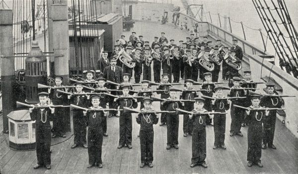 Boys taking part in an exercise drill, with the band behind them, on the Training Ship Wellesley, on the River Tyne at North Shields, Northumberland. In 1868, James Hall and other local businessmen set up a charity to provide shelter for Tyneside waifs