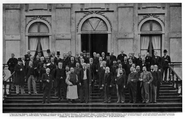 Delegates of the International Peace Conference held at the Royal House in the Wood, The Hague, Netherlands, stand on the steps for a group photographic portrait. Date: 18 May 1899