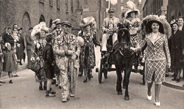 A procession of pearly Kings and Queens, Southwark, London