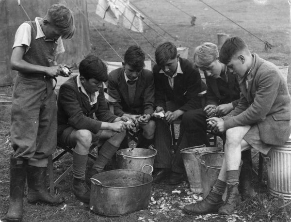 Boys peeling potatoes at a Harvest camp at Great Easton, Leicestershire