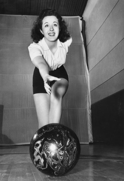 Peggy Moran, one of Hollywood's top-ranking female bowlers, boasting an average score of 175
