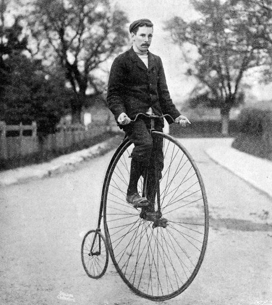 Photograph of a 'Penny Farthing' or 'Ordinary' bicycle of the 1870's, with its rider wearing contemporary cycling clothes