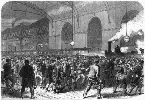 The workmen's 'penny train' arrives at Victoria Station, Central London, just before 6am each workday. Date: 1865