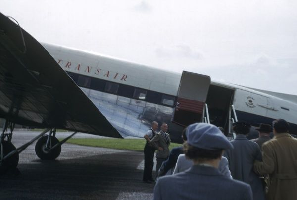 A group of people boarding an aeroplane operated by Transair, in Vienna, Austria. (1 of 3)
