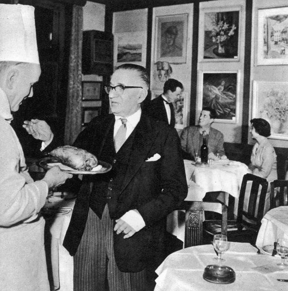 Peppino Leoni, a native of Cannero, on the shores of Lake Maggiore, seen here in his restaurant, Quo Vadis on Dean Street, Soho, London