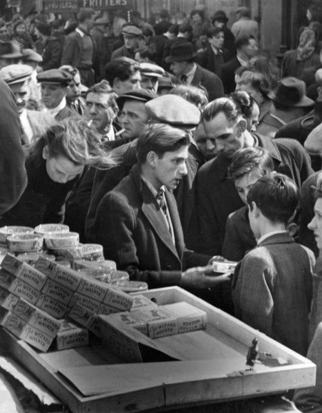 A busy scene at historic Petticoat Lane market in the East End of London in the late 1940s