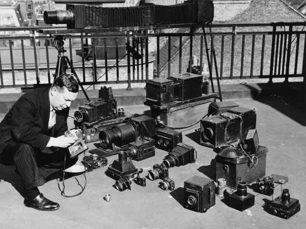 The Daily Mail photographer Frank Rust with an array of photographic equipment
