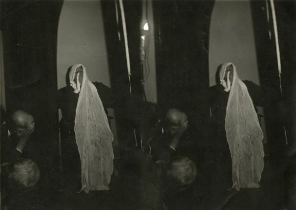 "Photograph of the Scottish medium Helen Duncan during sance with ""ectoplasm"" wrapped around her head and the end tucked into her nostrils, May 1931. A double photograph, possible for a stereoscope. HPG/1/4/2 (xi)&quot"