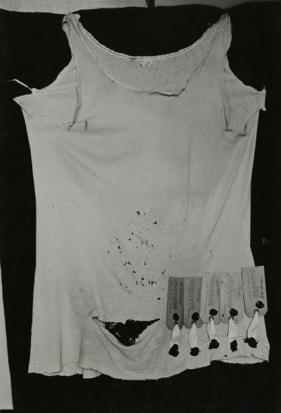 Photograph of undervest which, masquerading as the spirit Peggy, led to the Scottish medium Helen Duncans conviction for fraudulent mediumship at Edinburgh, 11 May 1933. The vest shows rips caused during a struggle, many pin-holes and identifying signatures