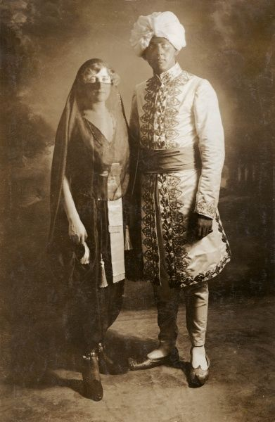 The actress and singer Phyllis Dare (1890-1975) with her elder brother Jack. They are dressed in costume for an Arabian Nights Ball