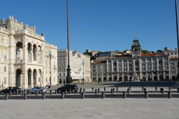 The Piazza dell'Unita d'Italia, Trieste, north east Italy, with a large government building on the left and the city hall on the right