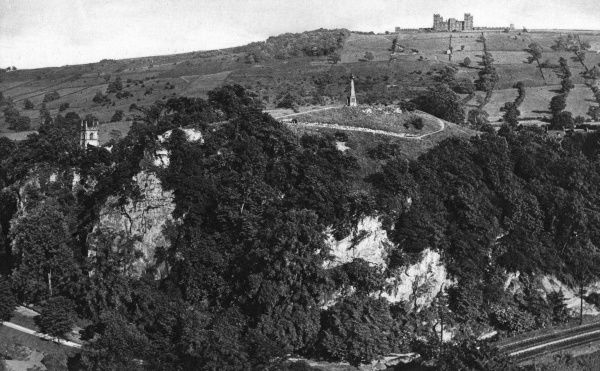 View of the Pic Tor War Memorial (centre, built in 1922) and Riber Castle on the distant horizon, overlooking Matlock, Derbyshire. Date: circa 1920s