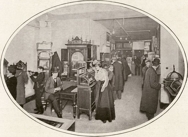 An amusement arcade in Piccadilly, in central London. Date: 1900