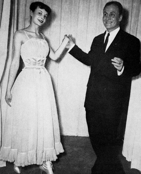Photograph showing Pierre Balmain presenting a pink and white petticoat, with gueppieres that helped to achieve a 48 centimetre waist, 1948. The design was influenced by Christian Dior's 'New Look' collection of 1947, when Dior used a small