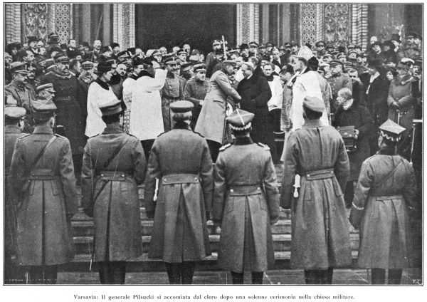 Marshal Jozef Piludski takes his leave of the clergy after a religious ceremony affirming the unity of his military government with the church