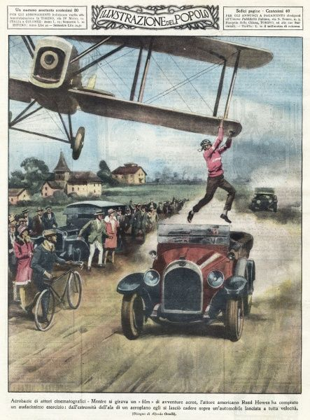 JUMPING FROM A PLANE American film actor Reed Howes drops from the wing of a biplane into a car travelling at full speed Date: 1928