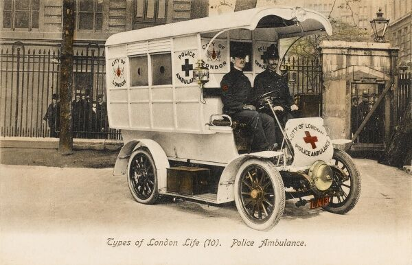 A fantastic photograph (hand-coloured) of a Police Ambulance in London, with open cab and a large alarm bell fixed at the front