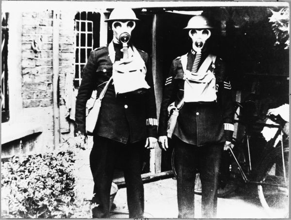 Two Metropolitan police officers from H district, London, fully kitted out for action during World War Two