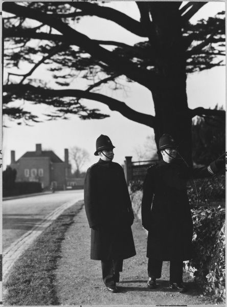 Two Metropolitan Police officers walking the beat
