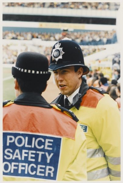 Police safety officers on duty in a stadium at a football match Metropolitan Police