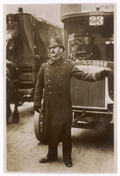 A policeman directs the London traffic