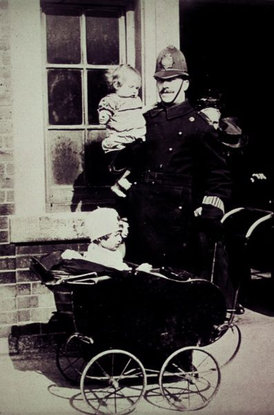 A policeman with two small children on a London street