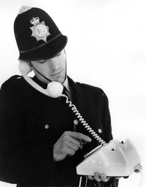 A young policeman makes a telephone call. Date: 1960s