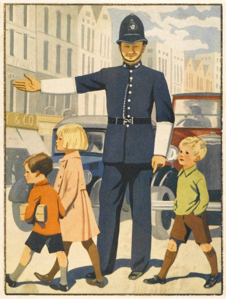 A policeman on traffic duty sees a group of children safely across a busy city street, holding up the traffic with outstretched arm