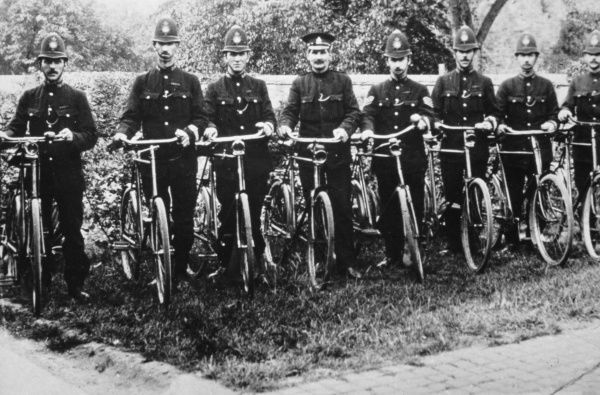 A group of policemen with their bicycles