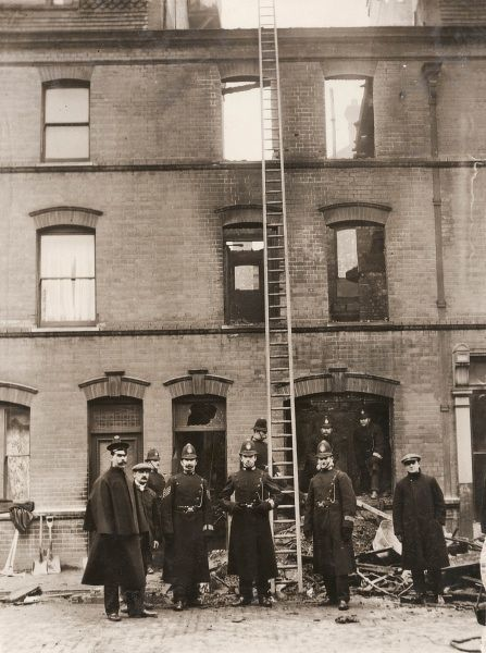 Policemen guarding the devastated house in Sidney Street, East London, after the Sidney Street Siege (popularly known as the Battle of Stepney) in East London
