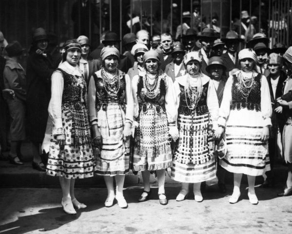 Five women of the Polish Colony (community) wearing tradional costumes for the Polish National Day celebrations, Paris, France. Date: 1930s