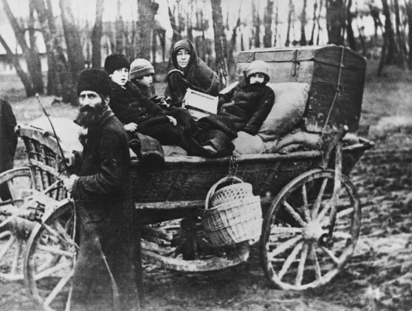 A family of Polish refugees with a cart containing their belongings