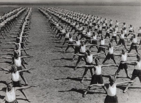 Long lines of Polish Boy Scouts doing physical exercises in the Middle East