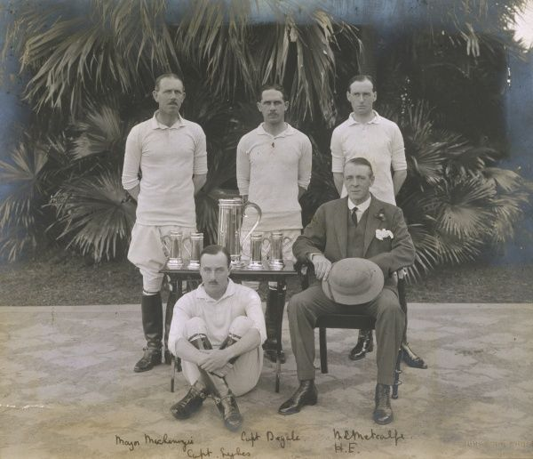A serious-looking British polo team, after winning a trophy, pose with His Excellency the Governor, who presumably has just presented the awards