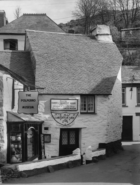 The quaint Polperro Museum, one of many old whitewashed buildings in this lovely fishing village in Cornwall, England. Date: 1950s