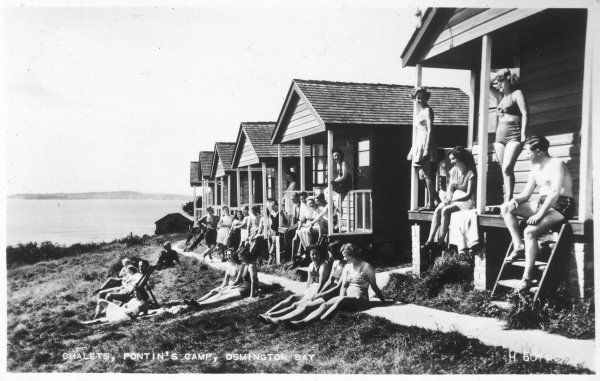 The guests outside the chalets at Pontin's Holiday Camp, Osmington Bay, Dorset, include a remarkable proportion of pretty girls and an even more remark- able absence of noisy kiddies