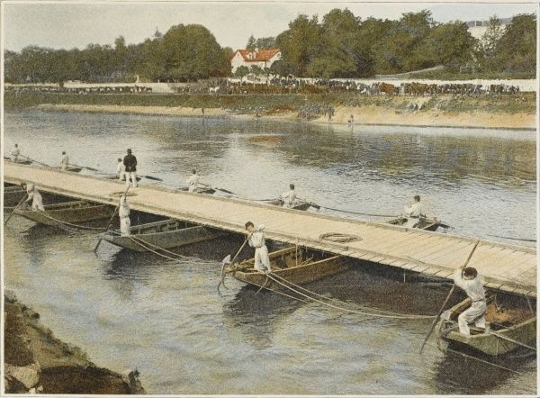 A temporary bridge is built by French engineers, utilising planks laid on boats, enabling troops to cross without getting their feet wet