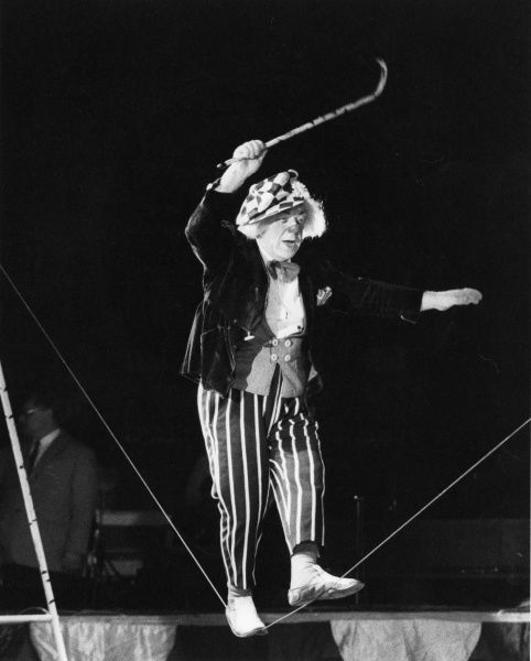 Popov the clown of the Moscow State Circus, defies gravity by walking the tightrope during a circus visit to Cornwall, England!