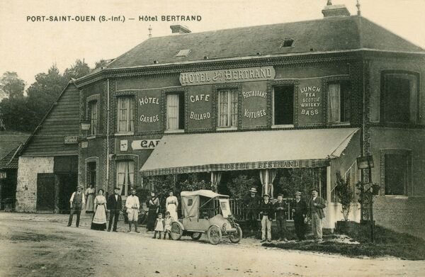 Port Saint-Ouen - Hotel Bertrand, incorporating a Cafe, Garage and Billiard Hall. There is a wonderful very early car parked at the front of the Hotel, surrounded by the staff and some guests
