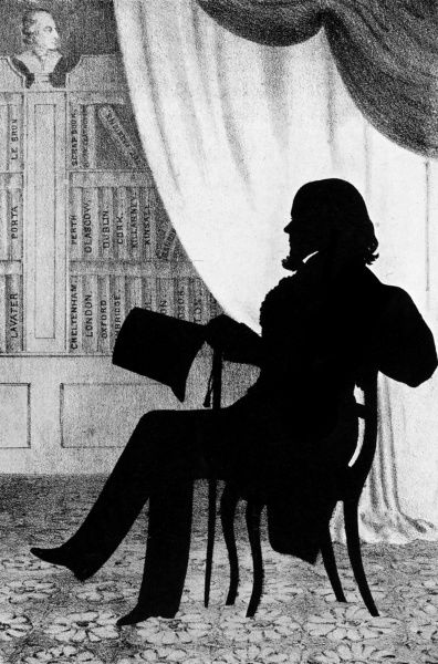 A portrait of August Edouart, the famous 19th century silhouettist, seated in his library where some of his folio volumes of silhouette portraits are on display. Date: c. 1840