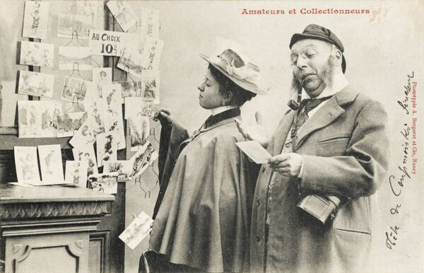 A fabulous French postcard depicting two postcard collectors