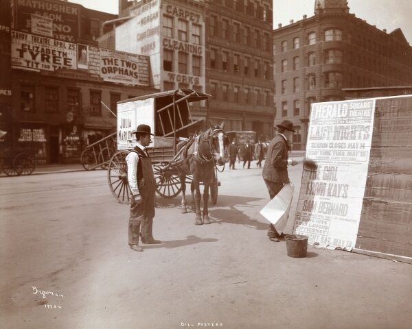 Bill Posters. Two men posting bills for the Herald Square Theatre performance of The Girl From Kay's with Sam Bernard, on a New York street