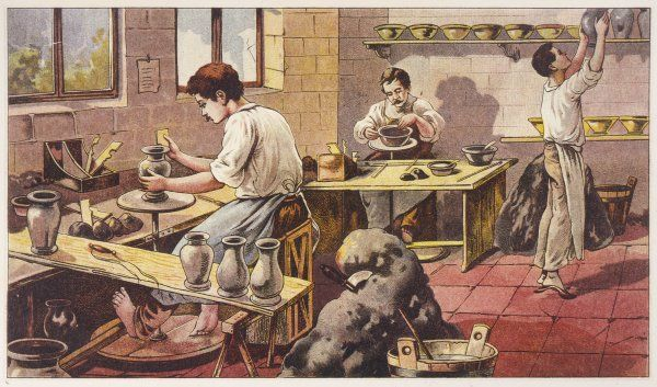 Potters at work, one barefoot at his wheel and his two colleagues finishing a bowl and putting a vase on a shelf on tiptoe
