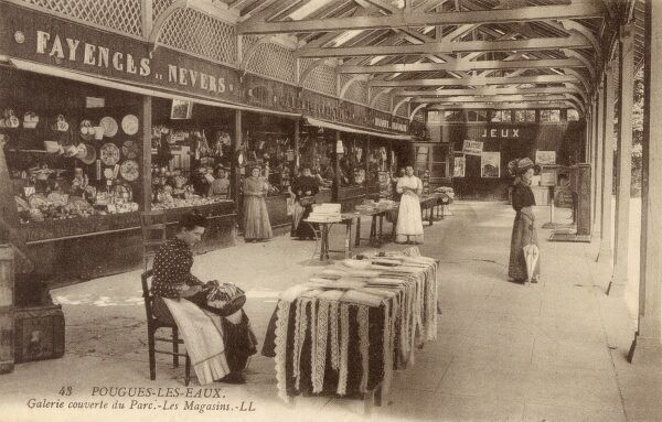 Pouges-Les-Eaux, in the Nievre department in central France - Shops in the Covered Gallery in the Park. Date: 1906