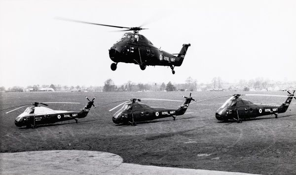Four pre-production S58 Wessex HAS1 helicopters, three grounded, one hovering Date