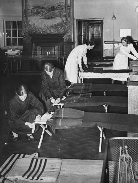 The Cheyne Hospital in London prepares to receive refugees. Camp beds are set up in the wards and the beds fixed with a number to identify the occupant