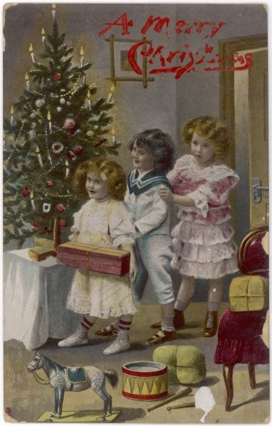 Three children, with presents and tree