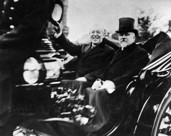 Thomas Woodrow Wilson (1856-1924), American President, with Raymond Poincare (1860-1934), President of France, greeting the crowds outside a Paris railway station at the end of the First World War. Date: 12 November 1918
