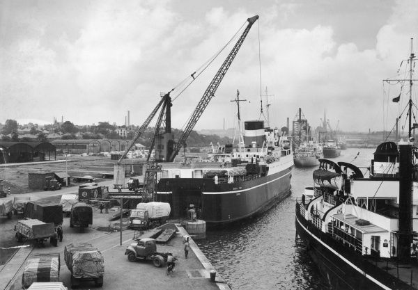 A wonderful photograph showing the 'Bardic Ferry' unloading British Road Services trucks while docked at the quayside in Preston, Lancashire. Photograph by Heinz Zinram