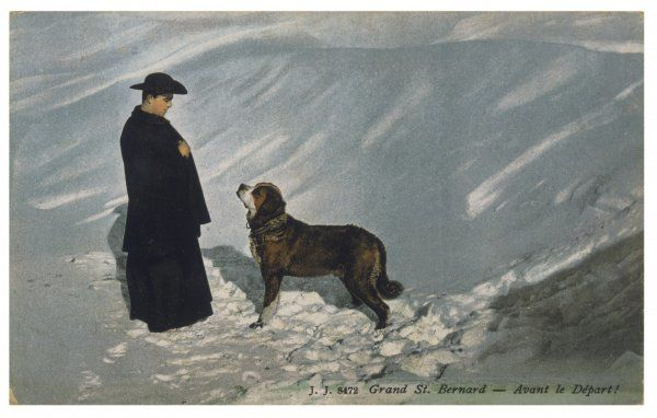 A priest from the hospice on the St Bernard pass, with one of the famous rescue dogs